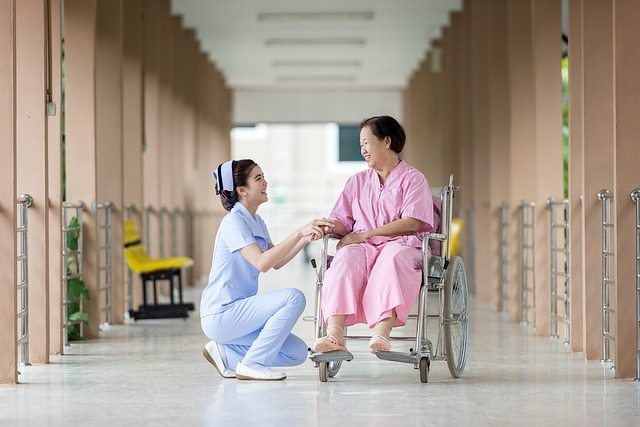 Asian Nurse with Patient